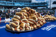 Hot dogs are stacked on platters before the world's best eating athletes go head-to-head in the 10-minute, all-you-can-eat contest at the Nathan's Famous Fourth of July International Hot Dog-Eating Contest in Coney Island's Maimonides Park on Sunday, July 4, 2021, in New York. (AP Photo/Brittainy Newman)