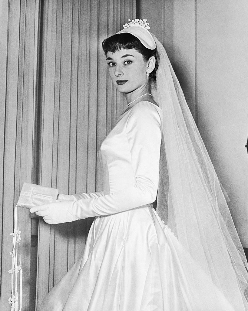 <p>Audrey Hepburn poses in her wedding gown. The actress tied the knot twice, spousing film producer Mel Ferrer from 1954–1968 and Italian psychiatrist Andrea Dotti from 1969–1982.</p>