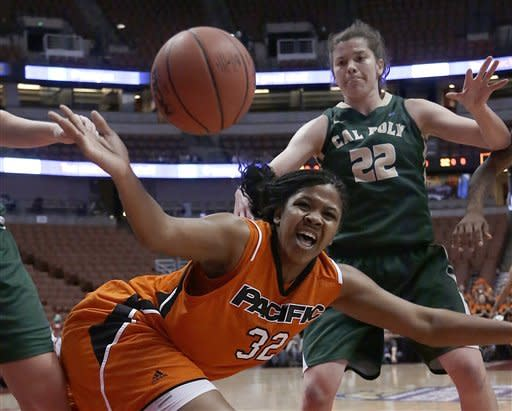 Pacific forward Shanice Butler (32) loses the ball as Cal Poly's Caroline Reeves (22) defends during the first half of an NCAA college basketball game for the Big West women's tournament title in Anaheim, Calif., Saturday, March 16, 2013. (AP Photo/Reed Saxon)