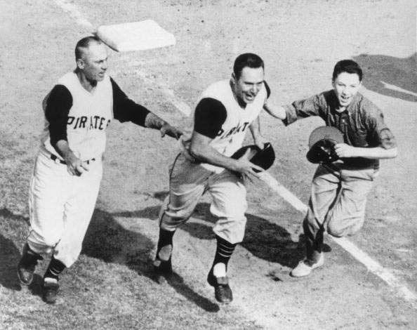 """<p><strong>October 13, 1960</strong>: Pirates second baseman Bill Mazeroski hits the first World Series-winning homer in baseball history, providing a thrilling conclusion to one of the greatest games ever played. Having been outscored by the Yanks in the previous six games by a combined score of 46-17 and surrendering their 9-7 lead in Game 7, the Pirates send Mazeroski to lead off the bottom of the ninth against pitcher Ralph Terry. Maz swings away and smashes the ball over the leftfield wall, propelling the underdog Bucs to victory. """"It culminates a storybook World Series win by the Pirates,"""" says Thorn.<br> </p>"""