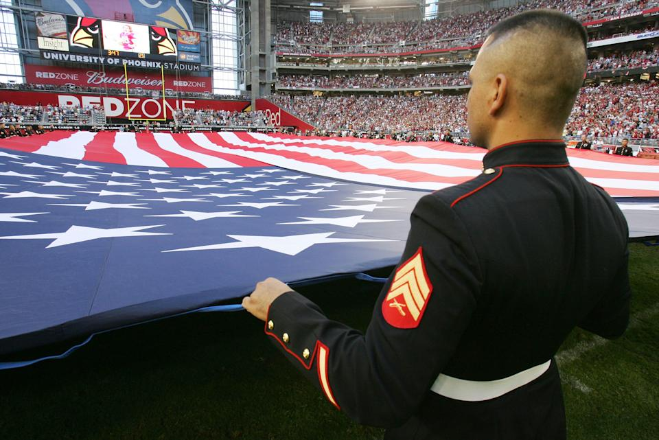 Pat Tillman, who was killed in Afghanistan in 2004 after quitting the NFL's Arizona Cardinals to join the U.S. Army Rangers, is honored as the Cardinals retire Pat Tillman's #40 at half time of the game against the Dallas Cowboys on November 12, 2006 at University of Phoenix Stadium in Glendale, Arizona. The Cowboys defeated the Cardinals 27-10. (Photo by Robert Laberge/Getty Images)