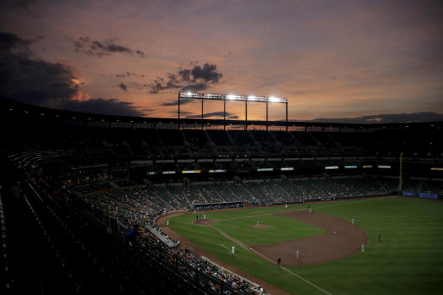 A crowd watches the third inning of a baseball game between the Baltimore Orioles and the Kansas City Royals, Wednesday, Aug. 21, 2019, in Baltimore. (AP Photo/Julio Cortez)