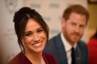FILE PHOTO: Britain's Meghan, the Duchess of Sussex, and Prince Harry, Duke of Sussex, attend a roundtable discussion on gender equality with The Queen's Commonwealth Trust (QCT) and One Young World at Windsor Castle
