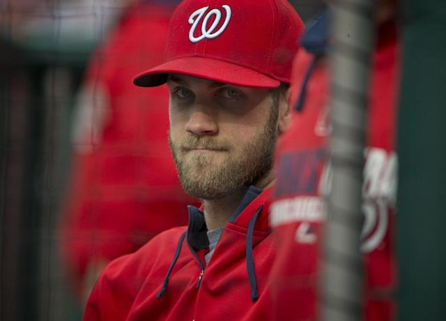 Washington Nationals outfielder Bryce Harper sits in dugout during a baseball game against the Los Angeles Dodgers, Wednesday, May 7, 2014 in Washington. Harper, who is on the disabled list, had surgery on his injured left thumb and will be out for an extended period of time. (AP Photo/Pablo Martinez Monsivais)