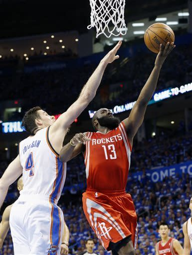 Houston Rockets guard James Harden(13) shoots in front of Oklahoma City Thunder forward Nick Collison (4) in the second quarter of Game 1 of their first-round NBA basketball playoff series in Oklahoma City, Sunday, April 21, 2013. (AP Photo/Sue Ogrocki)