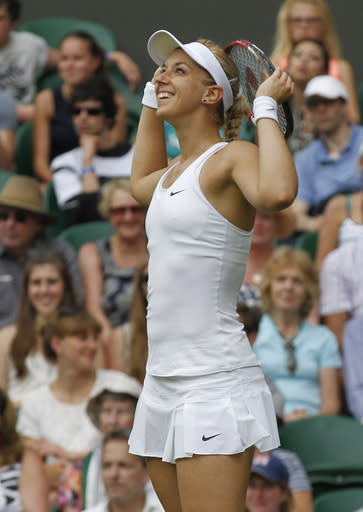 Sabine Lisicki of Germany smiles during her first round match against Julia Glushko of Israel at the All England Lawn Tennis Championships in Wimbledon, London, Tuesday, June 24, 2014. (AP Photo/Sang Tan)