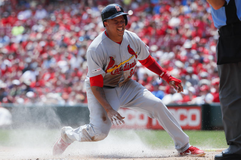 St. Louis Cardinals' Yairo Munoz slides in to score on a fielding error in the second inning of a baseball game, Sunday, July 21, 2019, in Cincinnati. (AP Photo/John Minchillo)