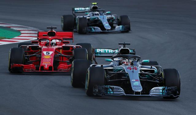 Formula One F1 - Spanish Grand Prix - Circuit de Barcelona-Catalunya, Barcelona, Spain - May 13, 2018 Mercedes' Lewis Hamilton leads Ferrari's Sebastian Vettel and Mercedes' Valtteri Bottas behind the safety car (not pictured) during the second lap of the race REUTERS/Albert Gea