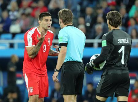 Soccer Football - World Cup - Group E - Serbia vs Switzerland - Kaliningrad Stadium, Kaliningrad, Russia - June 22, 2018 Serbia's Aleksandar Mitrovic talks to referee Felix Brych REUTERS/Mariana Bazo