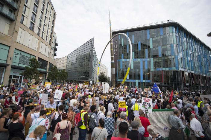 <p>Protestors gather outside Cardiff Library on the Hayes in Cardiff to protest against a visit by President Donald Trump on July 12, 2018 in Cardiff, Britain. (Photo: Matthew Horwood/Getty Images) </p>
