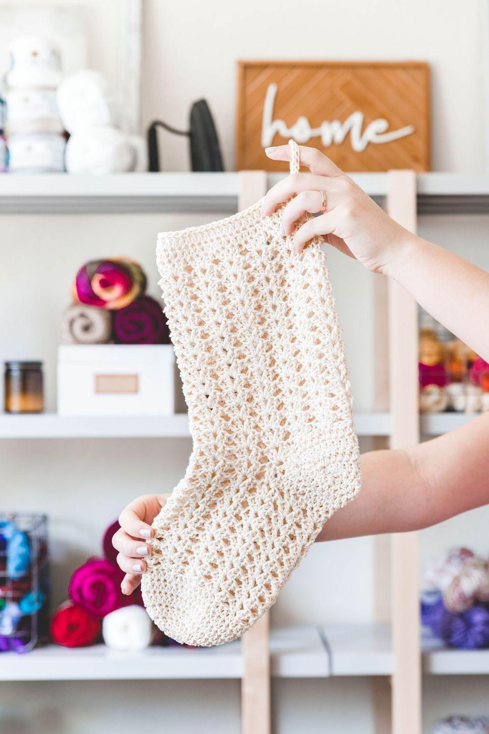 """<p>White, hand-knit blankets are certainly a fixture of farmhouse décor. But what if you applied that same aesthetic to your Christmas stocking? Follow this free pattern to make a <a href=""""https://www.countryliving.com/home-design/decorating-ideas/how-to/g860/farmhouse-style-0809/"""" rel=""""nofollow noopener"""" target=""""_blank"""" data-ylk=""""slk:farmhouse"""" class=""""link rapid-noclick-resp"""">farmhouse</a> stocking of your very own. <br> <strong><br>Get the tutorial at <a href=""""https://www.sewrella.com/crochet-farmhouse-christmas-stocking/"""" rel=""""nofollow noopener"""" target=""""_blank"""" data-ylk=""""slk:Sewrella"""" class=""""link rapid-noclick-resp"""">Sewrella</a>.</strong><br> <br><a class=""""link rapid-noclick-resp"""" href=""""https://www.amazon.com/Lion-Brand-Yarn-400-5-1117-Crochet/dp/B000ADYTAE/ref=sr_1_1?tag=syn-yahoo-20&ascsubtag=%5Bartid%7C10050.g.28872655%5Bsrc%7Cyahoo-us"""" rel=""""nofollow noopener"""" target=""""_blank"""" data-ylk=""""slk:SHOP CROCHET HOOKS"""">SHOP CROCHET HOOKS</a><br></p>"""