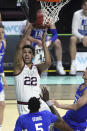 Gonzaga forward Anton Watson (22) shoots against BYU during the first half of an NCAA college basketball game for the West Coast Conference men's tournament championship Tuesday, March 9, 2021, in Las Vegas. (AP Photo/David Becker)