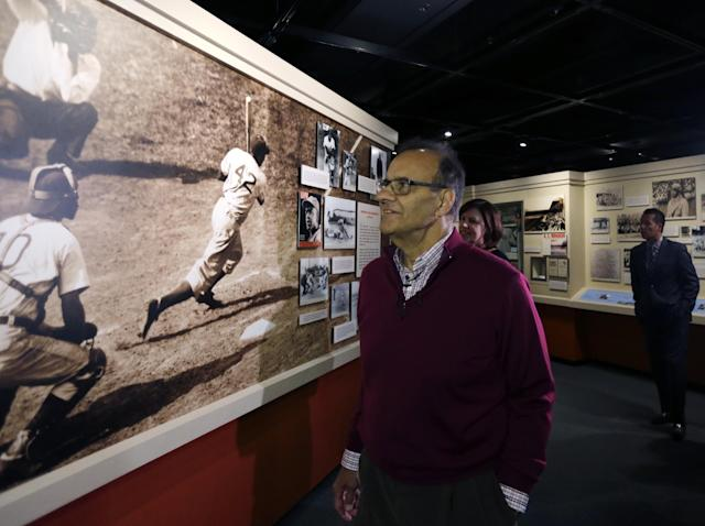 Former New York Yankees manager Joe Torre tours a Jackie Robinson exhibit during his orientation visit at the Baseball Hall of Fame on Tuesday, March 25, 2014, in Cooperstown, N.Y. Torre will be inducted to the hall in July. (AP Photo/Mike Groll)