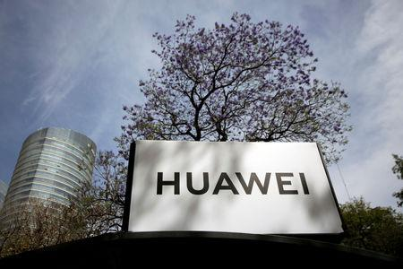 FILE PHOTO: The Huawei logo is seen at a bus stop in Mexico City, Mexico February 22, 2019. REUTERS/Daniel Becerril/File Photo