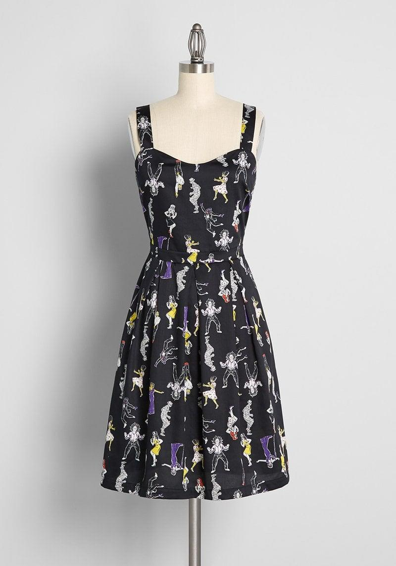 <p>The <span>Splendid Surprises Fit and Flare Dress</span> ($69) is a flattering dress that will get you into the spooky spirit. With a gorgeous neckline and a form-fitting silhouette, you'll want to wear this dress during Christmas too. It also comes in the witchcraft-inpired white print!</p>