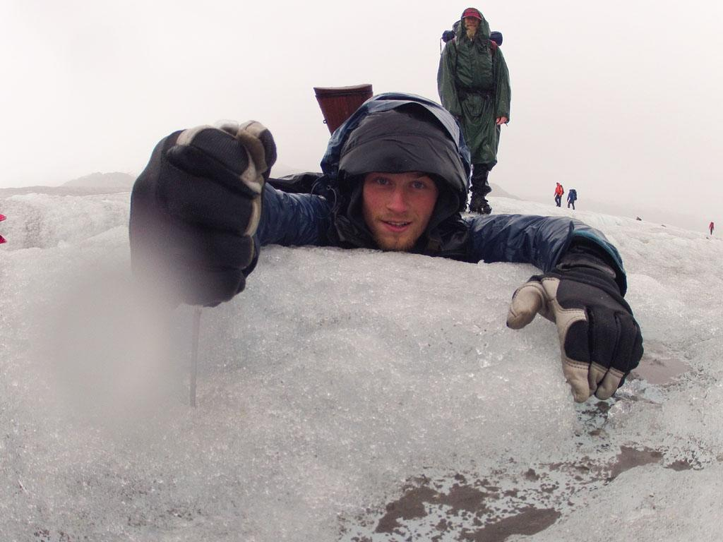 Tordrillo Mountains, Alaska, USA: Dallas Seavey holding onto an ice block.