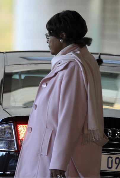 Winnie Madikizela-Mandela, the former wife of Nelson Mandela, leaves after visiting the Mediclinic Heart Hospital where former South African President Nelson Mandela is being treated in Pretoria, South Africa Tuesday, June 18, 2013. Well-wishers continued to send messages of love and support to Nelson Mandela, as he remained in hospital in a serious condition with a lung infection. (AP Photo/Themba Hadebe)