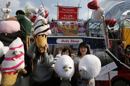 Vendors sell toy sheep inside a Lunar New Year market at Hong Kong's Victoria Park February 17, 2015. REUTERS/Bobby Yip