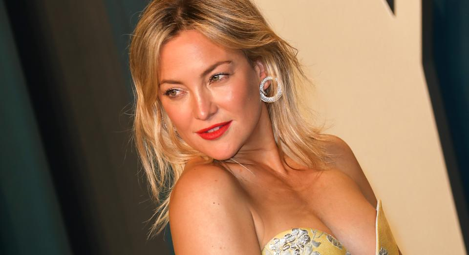 Kate Hudson has opened up about the unexpected strain on her hips and shoulders of being a mother. (Getty Images)
