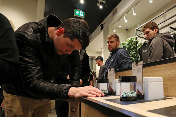 <p>A customer looks at cannabis on display after legal recreational marijuana went on sale at a Tweed retail store in St John's, Newfoundland and Labrador, Canada, Oct. 17, 2018. (Photo: Chris Wattie/Reuters) </p>