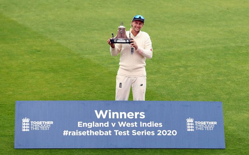 Joe Root was left all alone for a socially distanced celebration after reclaiming the Wisden Trophy - GETTY IMAGES
