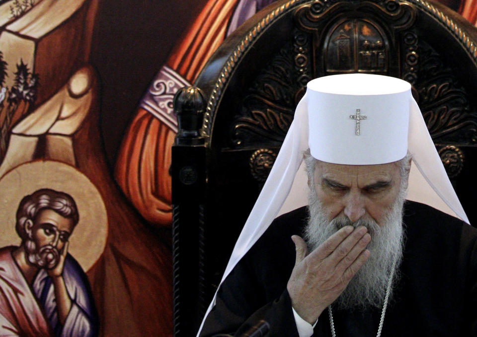 FILE - In this Jan. 5, 2012, file photo, Serbian Orthodox Church Patriarch Irinej gestures and reads his Christmas message in Belgrade, Serbia. The leader of the Serbian Orthodox Church, Patriarch Irinej, has died after testing positive for the coronavirus, the religious body said Friday, Nov. 20, 2020. He was 90.(AP Photo/Darko Vojinovic, File)