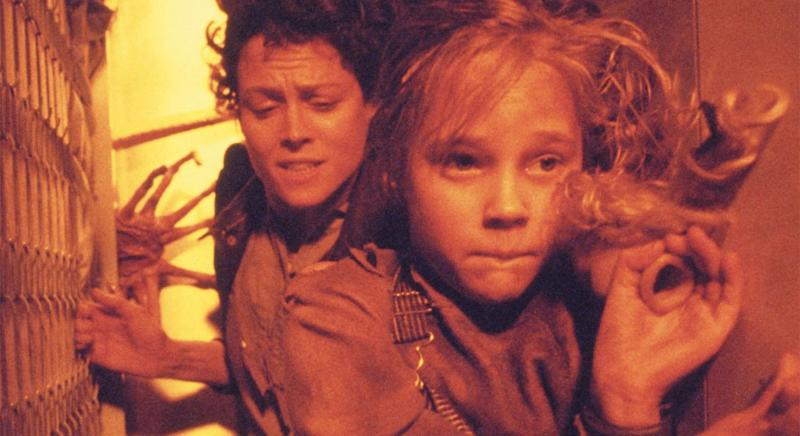 Sigourney Weaver and Carrie Henn run for their lives on Hadley's Hope (20th Century Fox)