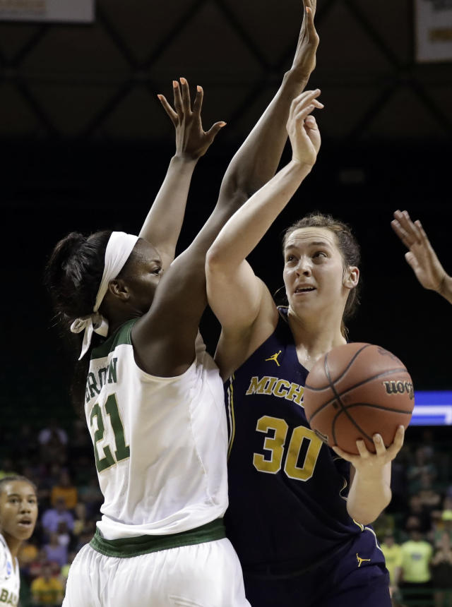 Baylor center Kalani Brown (21) defends in the paint as Michigan center Hallie Thome (30) works to the basket in the first half of a second-round game at the NCAA women's college basketball tournament in Waco, Texas, Sunday, March 18, 2018. (AP Photo/Tony Gutierrez)