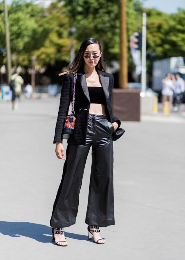<p>Beauty blogger Chriselle Lim wears wide leg trousers, a black bandeau, blazer, and heels to Paris Haute Couture Fashion week. (Photo: Getty) </p>