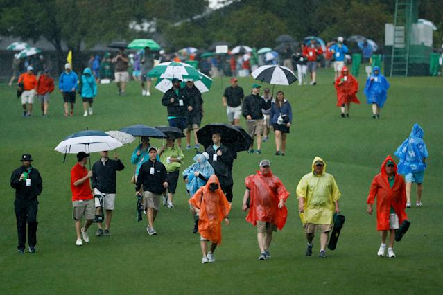 Rainy weather could cause trouble for the Masters on Sunday. (AP)
