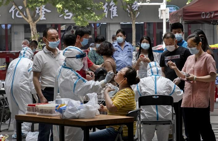 "People line up for coronavirus testing in Wuhan, China, where the city government has required that all residents be tested after new cases were reported on May 10, 2020. <span class=""copyright"">(For The Times )</span>"