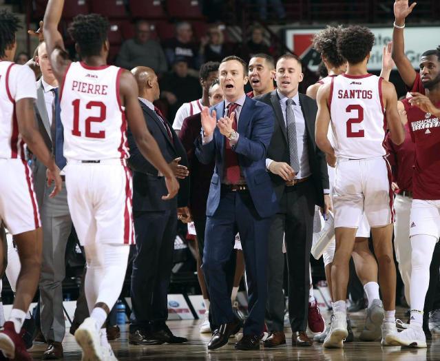 Massachusetts head coach Matt McCall, center, applauds his team play in the first half of an NCAA college basketball game against Maine in Amherst, Mass., Friday, Dec. 20, 2019. ( J. Anthony Roberts/The Republican via AP)