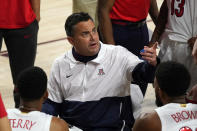 Arizona coach Sean Miller talks to the team during a timeout in the first half of the team's NCAA college basketball game against Arizona State, Thursday, Jan. 21, 2021, in Tempe, Ariz. (AP Photo/Rick Scuteri)