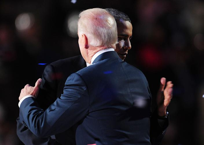 US Vice President Joe Biden hugs US President Barack Obama as they celebrate their victory on election night November 7, 2012 in Chicago, Illinois.    AFP PHOTO / Robyn Beck        (Photo credit should read ROBYN BECK/AFP/Getty Images)