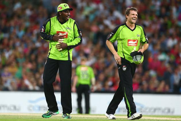 Chris Gayle and Dirk Nannes of the Thunder share a laugh after combining to remove Nic Maddinson of the Sixers share a laugh during the Big Bash League match between Sydney Thunder and the Sydney Sixers at ANZ Stadium on December 30, 2012 in Sydney, Australia.  (Photo by Mark Kolbe/Getty Images)