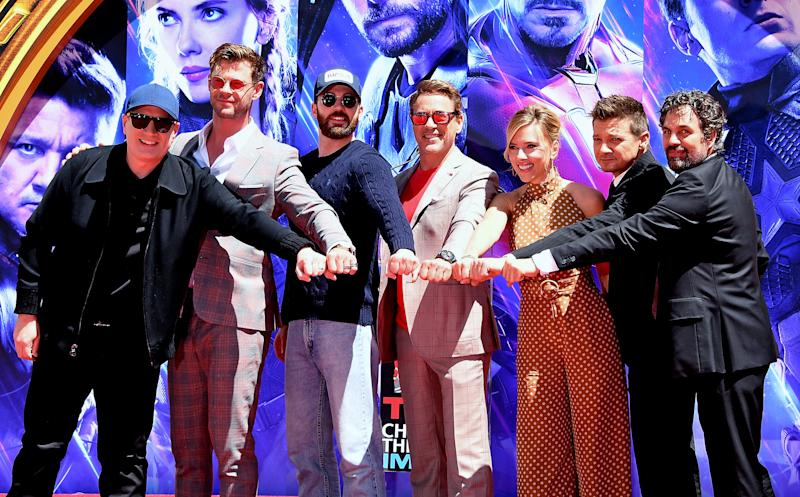"HOLLYWOOD, CALIFORNIA - APRIL 23: (L-R) President of Marvel Studios/Producer Kevin Feige, Chris Hemsworth, Chris Evans, Robert Downey Jr., Scarlett Johansson, Jeremy Renner, and Mark Ruffalo attend the Marvel Studios' ""Avengers: Endgame"" cast place their hand prints in cement at TCL Chinese Theatre IMAX Forecourt at TCL Chinese Theatre IMAX on April 23, 2019 in Hollywood, California. (Photo by Steve Granitz/WireImage)"