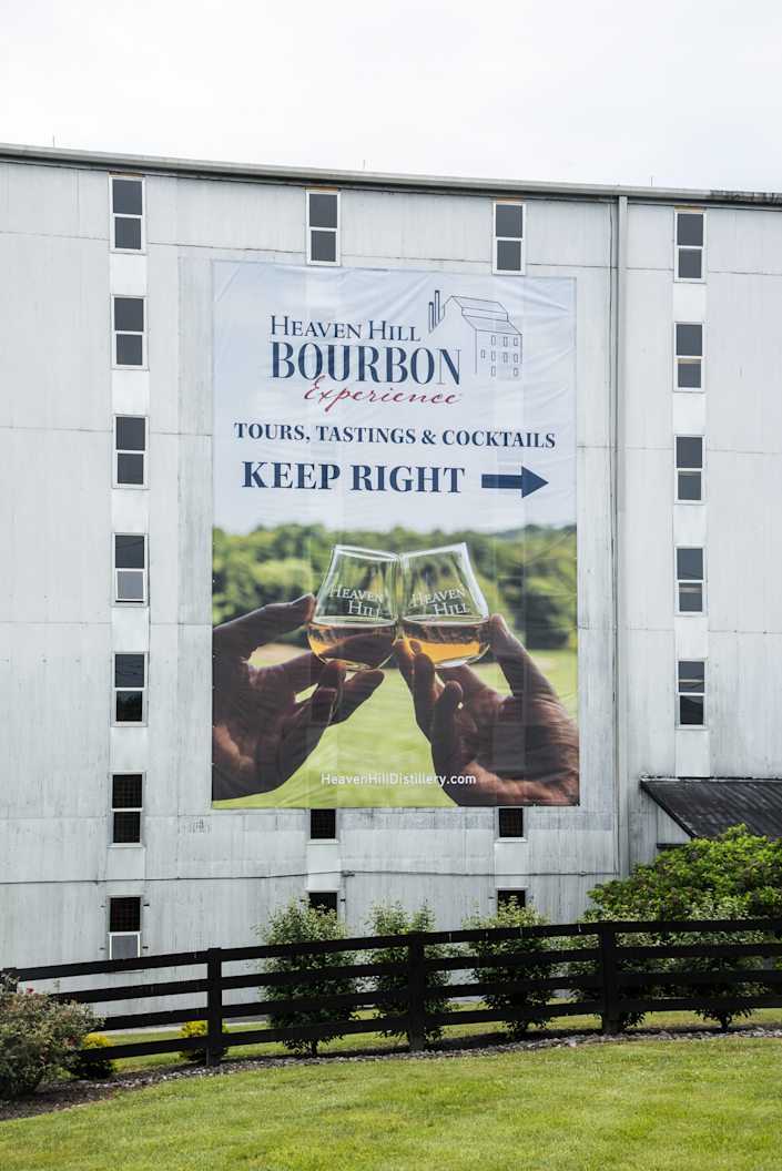 A new sign directs Bardstown visitors to the Heaven Hill Bourbon Experience. You can sign up for tours online. Bourbon tourism took a big hit in 2020 but Kentucky distilleries are hoping to rebound.