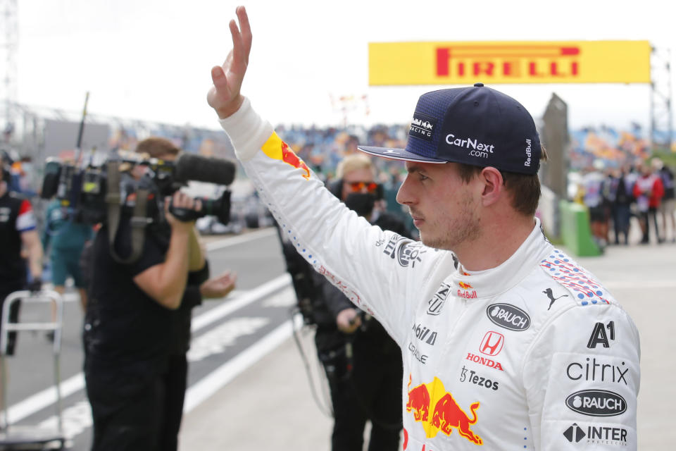Red Bull driver Max Verstappen of the Netherlands waves to the crowd as he walks from his car after qualifying Sunday's Formula One Turkish Grand Prix at the Intercity Istanbul Park circuit in Istanbul, Turkey, Saturday, Oct. 9, 2021. Verstappen will start in second place after Mercedes driver Lewis Hamilton of Britain who was fastest was give a 10 place penalty with Hamiton';s teammate Mercedes driver Valtteri Bottas of Finland now on pole. (Umit Bektas/Pool Photo via AP)
