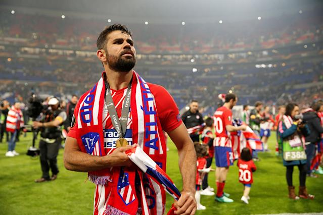Soccer Football - Europa League Final - Olympique de Marseille vs Atletico Madrid - Groupama Stadium, Lyon, France - May 16, 2018 Atletico Madrid's Diego Costa celebrates with his medal after winning the Europa league REUTERS/John Sibley