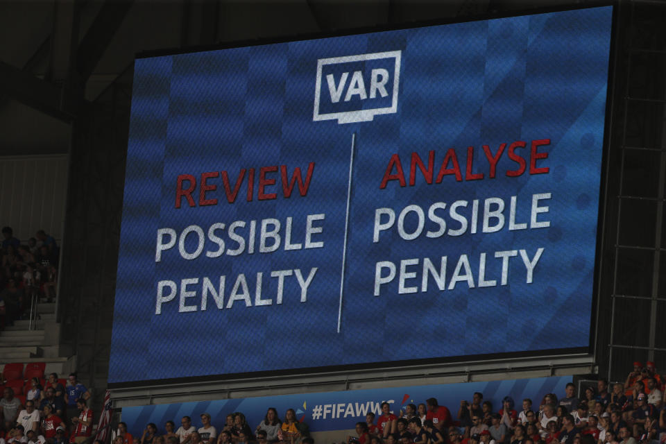 Video VAR is required for a possible penalty during the Women's World Cup final soccer match between US and The Netherlands at the Stade de Lyon in Decines, outside Lyon, France, Sunday, July 7, 2019. (AP Photo/Claude Paris)