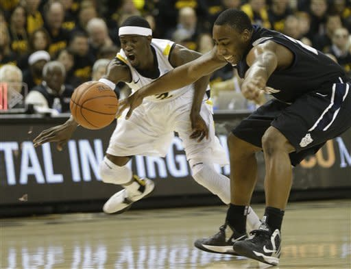 Virginia Commonwealth guard Briante Weber (2) steals the ball from Butler forward Roosevelt Jones (21) during the first half of an NCAA college basketball game in Richmond, Va., Saturday, March 2, 2013. (AP Photo/Steve Helber)