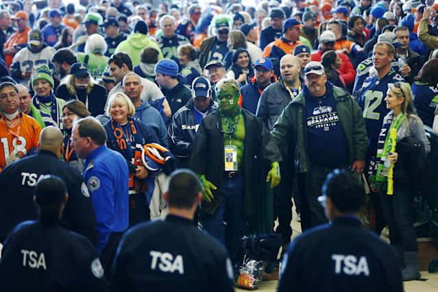 Football fans wait to go through security at the Secaucus Junction, Sunday, Feb. 2, 2014, in Secaucus, N.J. The Seattle Seahawks are scheduled to play the Denver Broncos in the NFL Super Bowl XLVIII football game on Sunday, evening at MetLife Stadium in East Rutherford, N.J. (AP Photo/Matt Rourke)