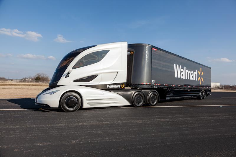 A modern-looking Walmart tractor-trailer making a turn on a desolate highway..