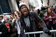 An Occupy Wall Street protestor yells as he is restricted from walking through police barriers during a march on the offices of pharmaceutical giant Pfizer, Wednesday, Feb. 29, 2012, in New York. There was a heavy police presence around the 42nd Street area as the demonstration began Wednesday morning. (AP Photo/John Minchillo)