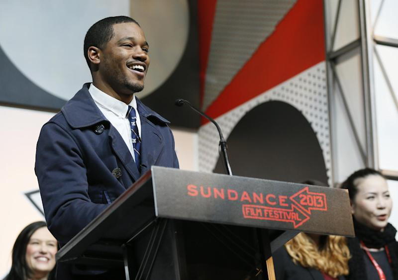 """Director Ryan Coogler accepts the U.S. Dramatic Audience Award for the film """"Fruitvale"""" during the 2013 Sundance Film Festival Awards Ceremony on Saturday, Jan. 26, 2013, in Park City, Utah. (Photo by Danny Moloshok/Invision/AP)"""