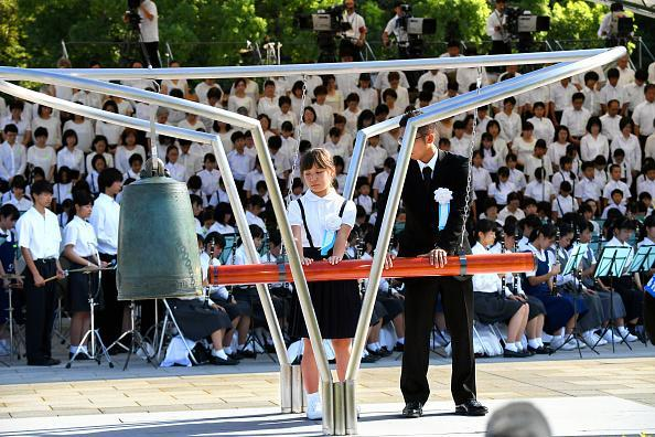 Representatives of bereaved family members hit the Peace Bell during the Peace Memorial Ceremony at Hiroshima Peace Memorial Park on the 73rd anniversary of the Hiroshima A-Bomb dropping on August 6, 2018 in Hiroshima, Japan. The first atomic bomb was dropped on August 6, 1945 at the end of the World War II. (Photo by The Asahi Shimbun via Getty Images)
