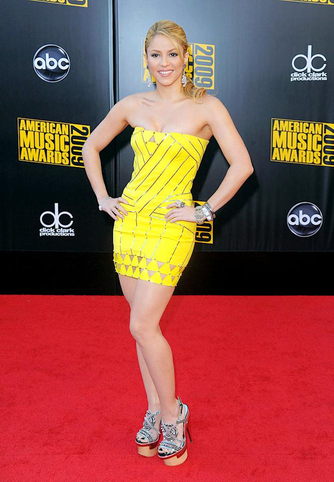 "Shakira  Grade: A-  The sexy ""She Wolf"" songstress strutted her stuff at the 2009 AMA Awards in a bright yellow mini and sky-high platform heels. Steve Granitz/<a href=""http://www.wireimage.com"" target=""new"">WireImage.com</a> - November 22, 2009"