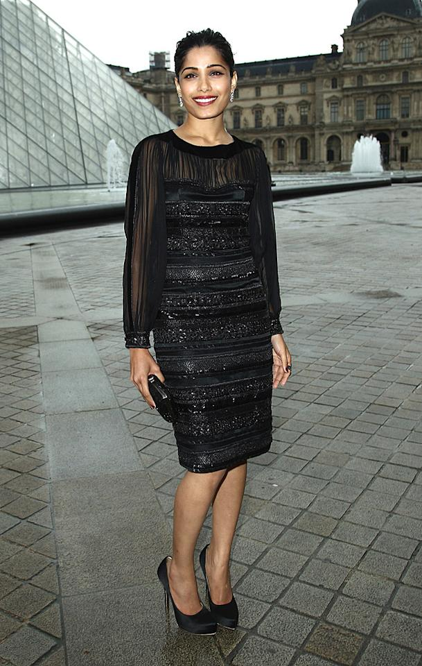 "And last but not least we have Freida Pinto, who oozed elegance in Salvatore Ferragamo as she entered the fashion house's ""Cruise Collection"" show at Galerie Denon in Paris. A sophisticated bun, silver earrings, and black heels completed the ""Slumdog Millionaire"" star's ensemble. (6/12/2012)<br><br><a target=""_blank"" href=""http://bit.ly/lifeontheMlist"">Follow 2 Hot 2 Handle creator, Matt Whitfield, on Twitter!</a>"