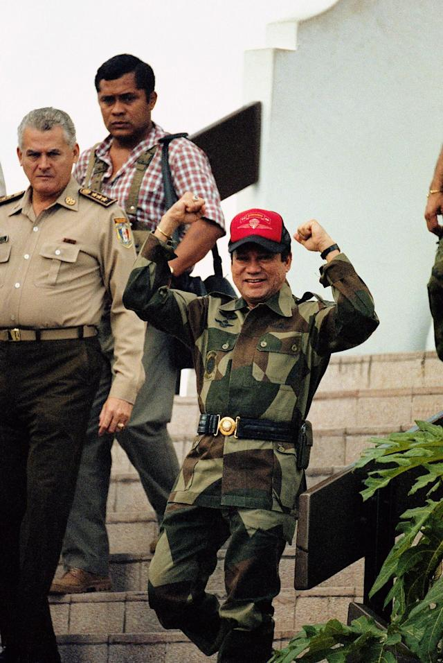<p>Panamanian Gen. Manuel Antonio Noriega emerges from his military headquarters in Panama City, Oct. 4, 1989, a day after a failed coup attempt. President George H.W. Bush refuses to rule out military action to oust the leader, but the next U.S. moves are more likely to involve dollars than bullets. (AP Photo/John Hopper) </p>