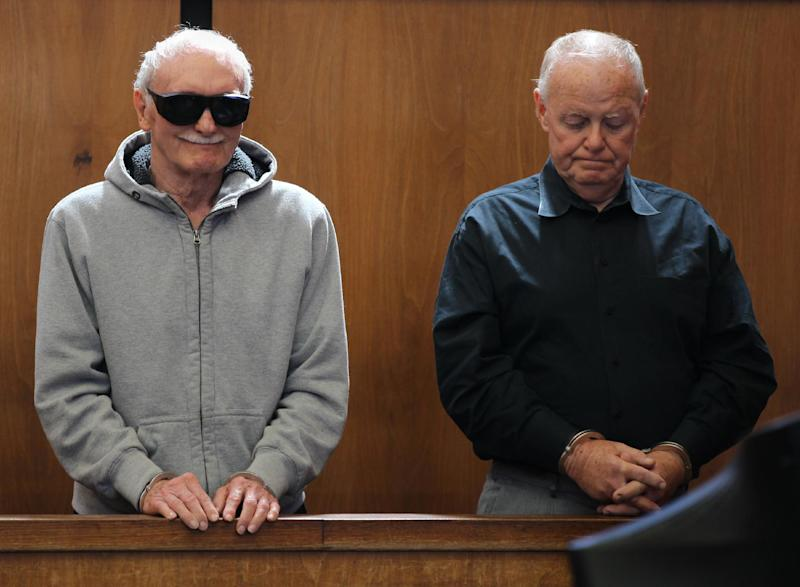 """Howard """"Howie"""" Winter, left, reacts to charges being read as James Melvin looks down during their arraignment at Somerville District Court on Friday, June 8, 2012 in Somerville, Mass. Winter, 83, and Melvin, 70, were arrested Thursday after authorities said they tried over several months to extort $35,000 from each of two men who had arranged a $100,000 loan for a third man. Both men pleaded not guilty to attempted extortion and conspiracy charges. Winter is the former head of the Winter Hill Gang, that was later run by James """"Whitey"""" Bulger. (AP Photo/The Boston Globe, Jonathan Wiggs, Pool)"""